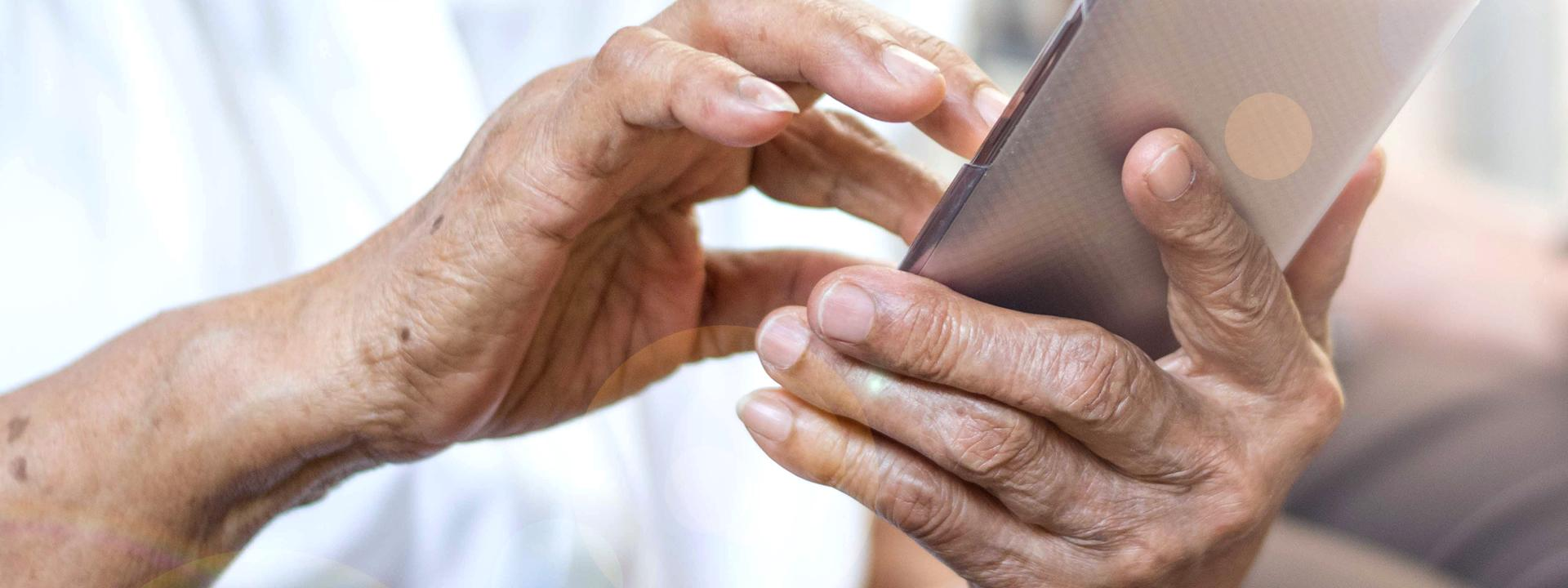 A resident using his iPad to access the apps for Eskaton Connect system.