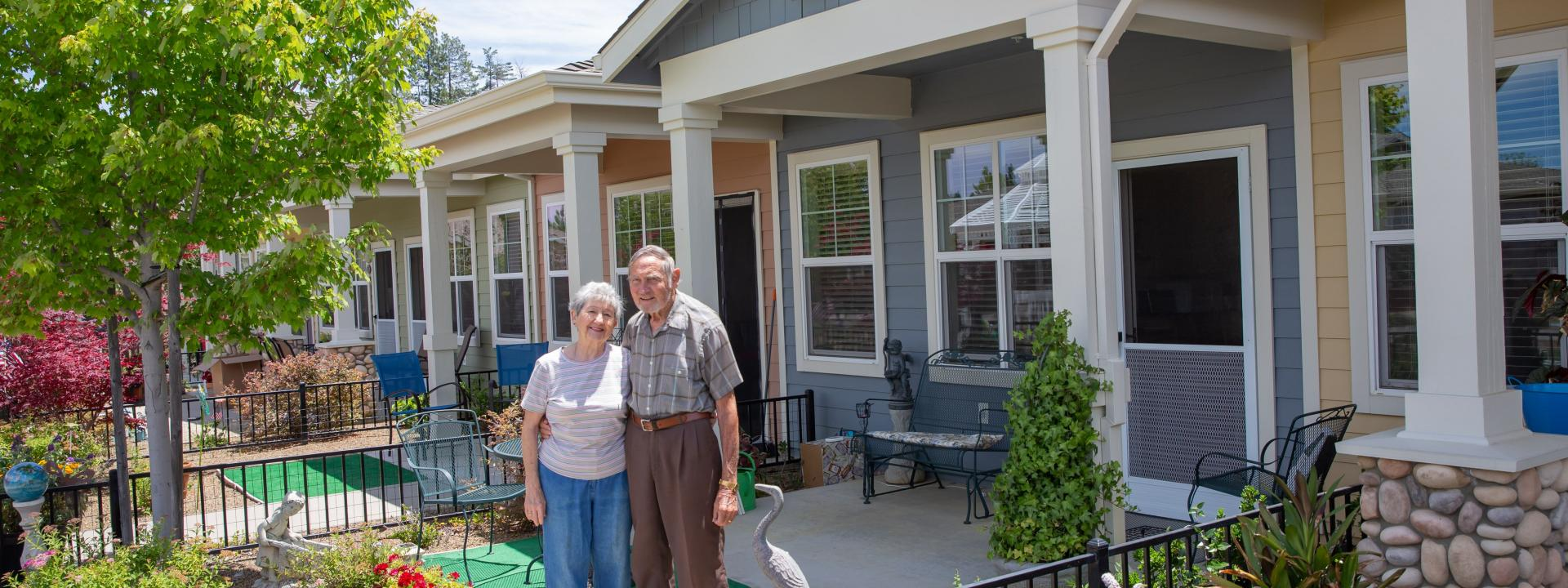 Smiling couples outside in front of their patio home