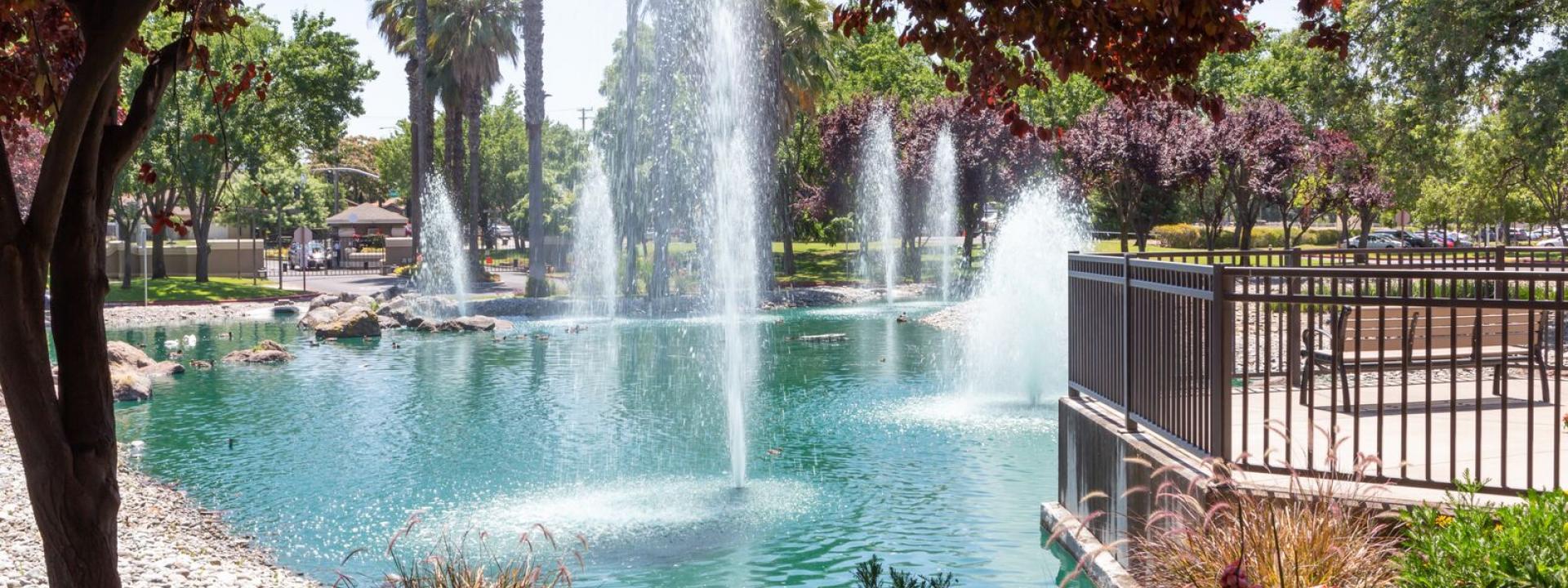 Continuing Care Retirement Community CCRC Sacramento - Beautiful Eskaton Village Carmichael with pond, fountains, and outdoor deck
