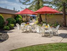 Outdoor patio with tables, chairs and umbrellas