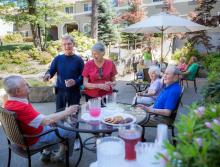 Residents socializing on the patio.
