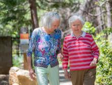 Residents walking along the beautiful walking trail at Eskaton Village Grass Valley.