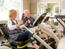 OCW-couple working out in the gym on stationary bikes