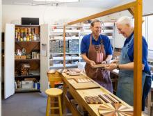 Two men working together in the wood work shop