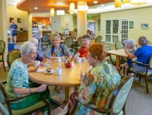 A group of women socializing at the community Bistro