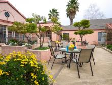Community outside patio with table and chair