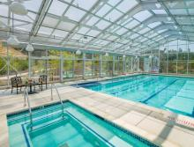 Indoor pool and spa with patio table and chairs