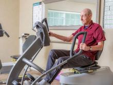 Male resident exercising at the community gym