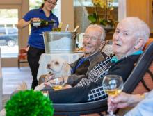 Residents enjoying a glass wine