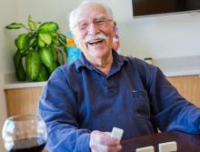 Happy and smiling resident playing Domino