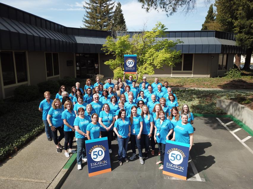 Group of Eskaton employees with Celebrating 50 Years signs