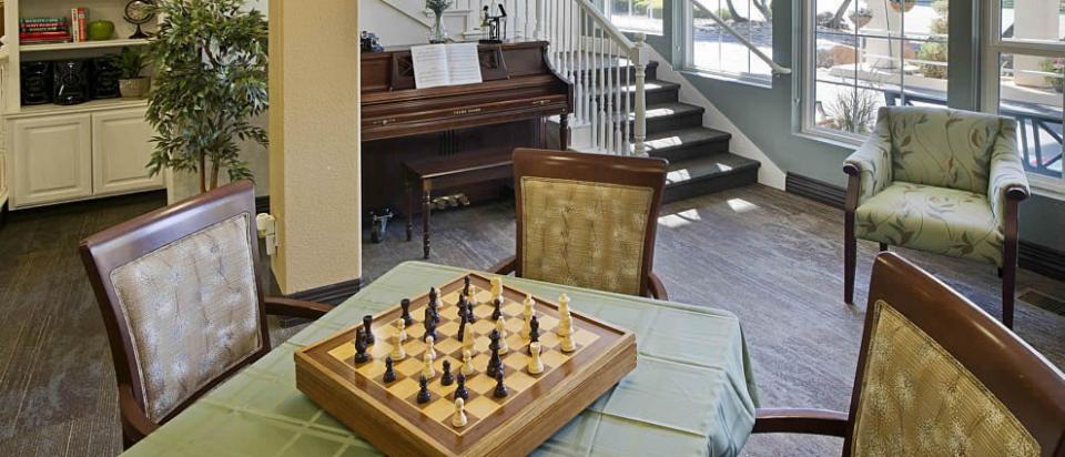 A chess set on a table in the game room.