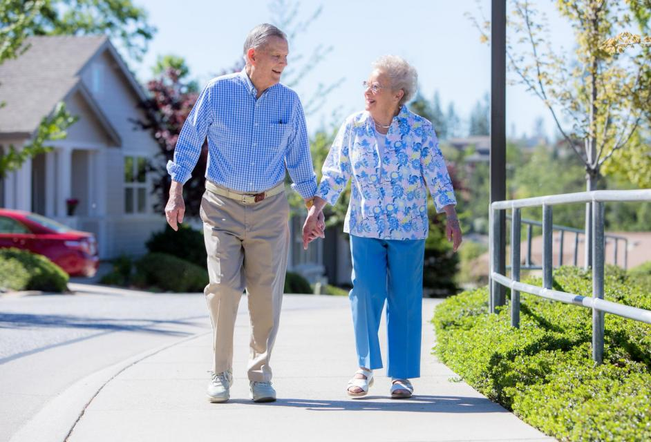 Residents couple walking the beautiful grounds at Eskaton Village Grass Valley.