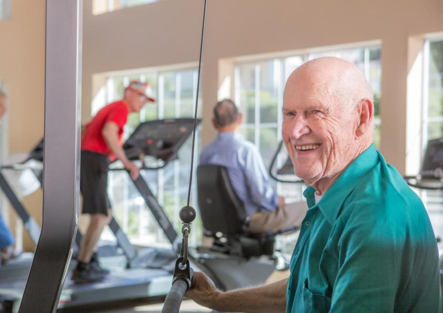 Residents working out in the community gym.
