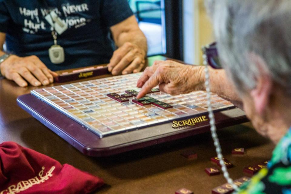 Residents playing Scrabble
