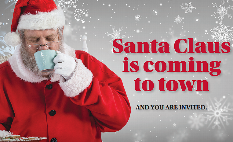 Santa siping coffee and holding a plate of cookies...He's coming to Eskaton Village Roseville