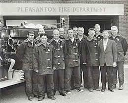 Resident Bob Juniper in his younger years standing in front of the Pleasanton Fire Department with all his fellow firemen.