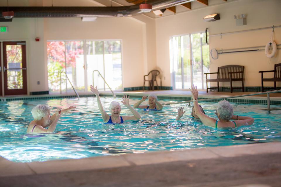Resident in the in-door pool doing water aerobics