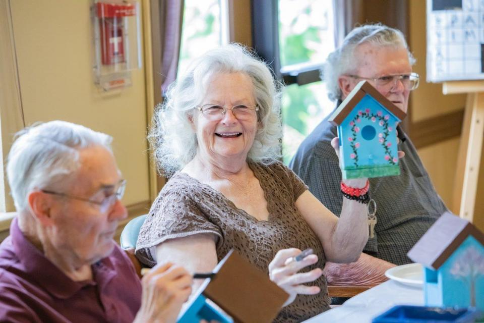 Residents painting bird houses