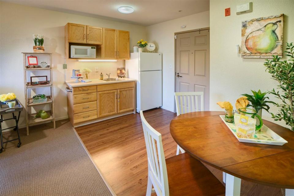Apartment kitchenette and dining room area.