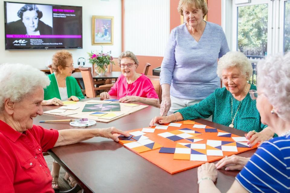 Six women at a quilting class