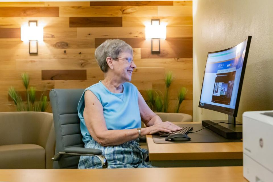 woman at a computer looking up community activities