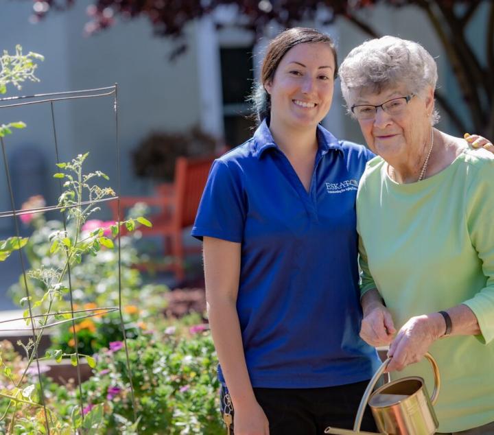 Eskaton staff taking a walk with a resident