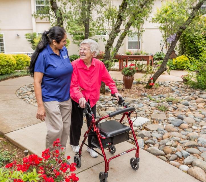 Resident and staff taking a walk