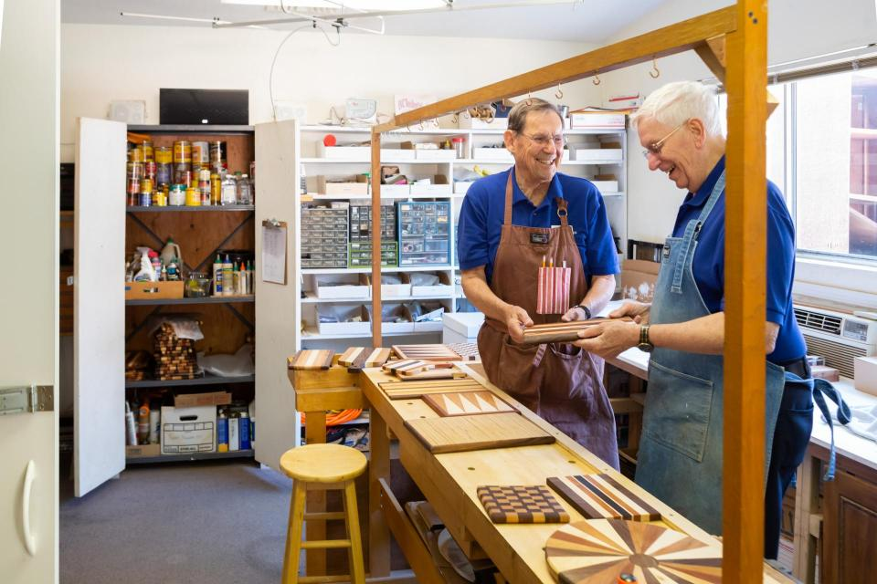 Two male residents working in community woodwork shop