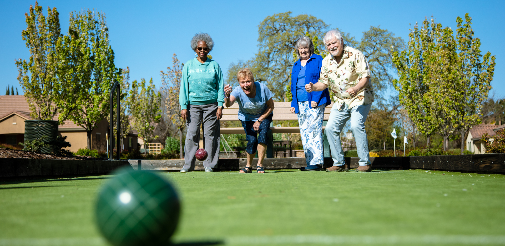 Four residents playing bocce ball